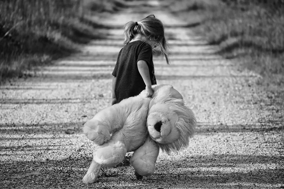 Child with large teddy
