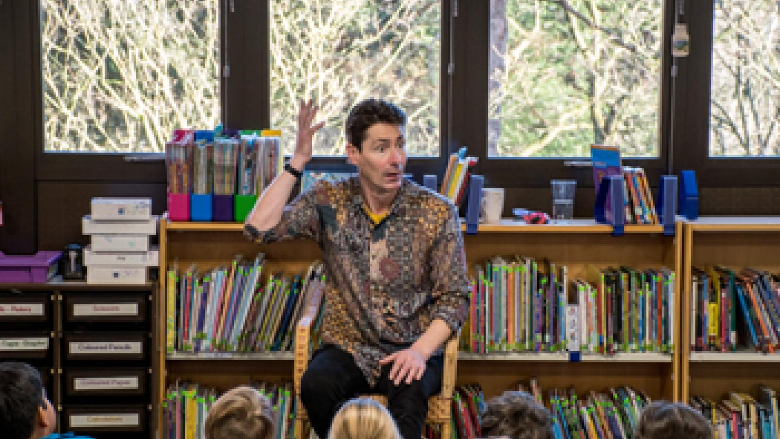 Niall De Burca telling a story to Lower School students