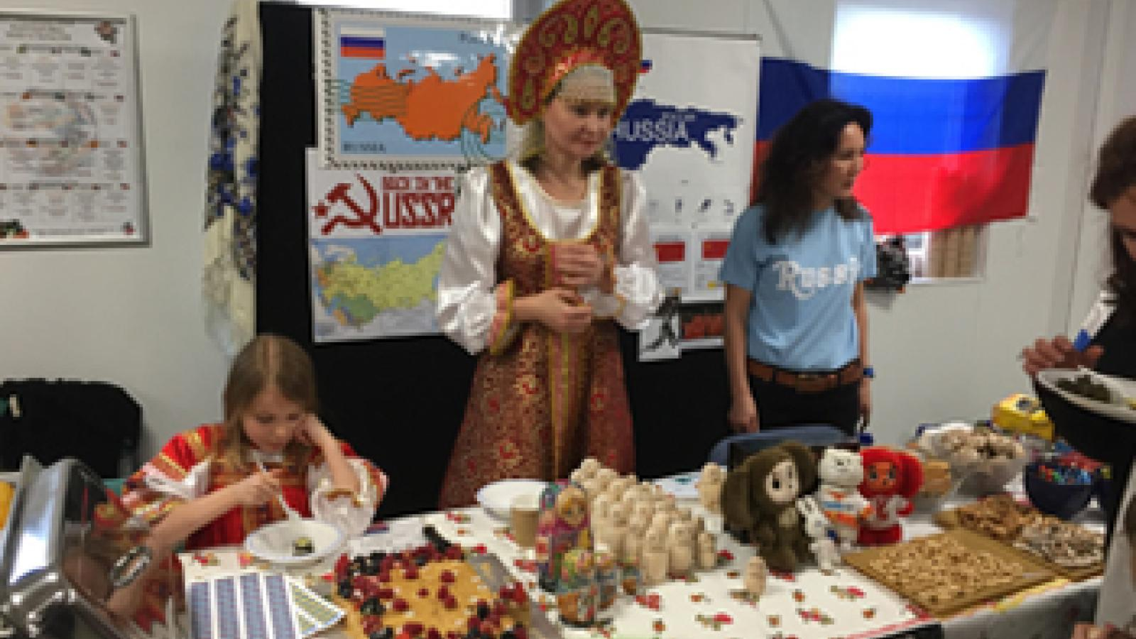 Egham parent dressed in traditional Russian clothing