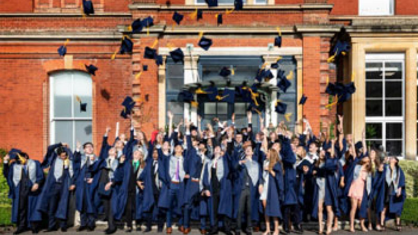 Egham 2018 graduating students during hat toss
