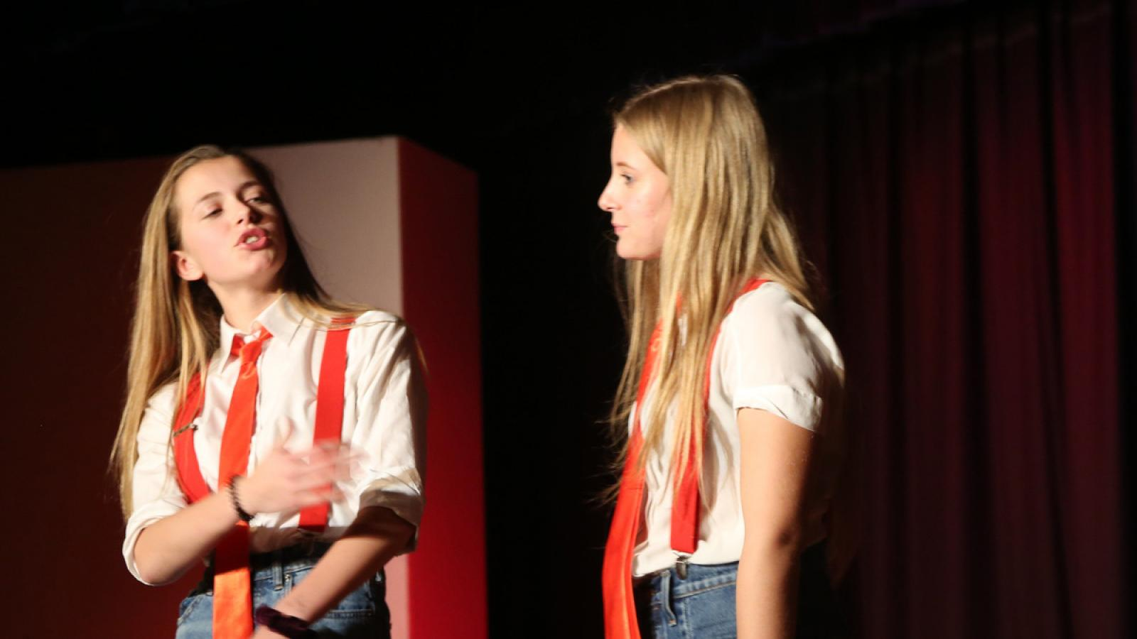 Two girls acting on stage