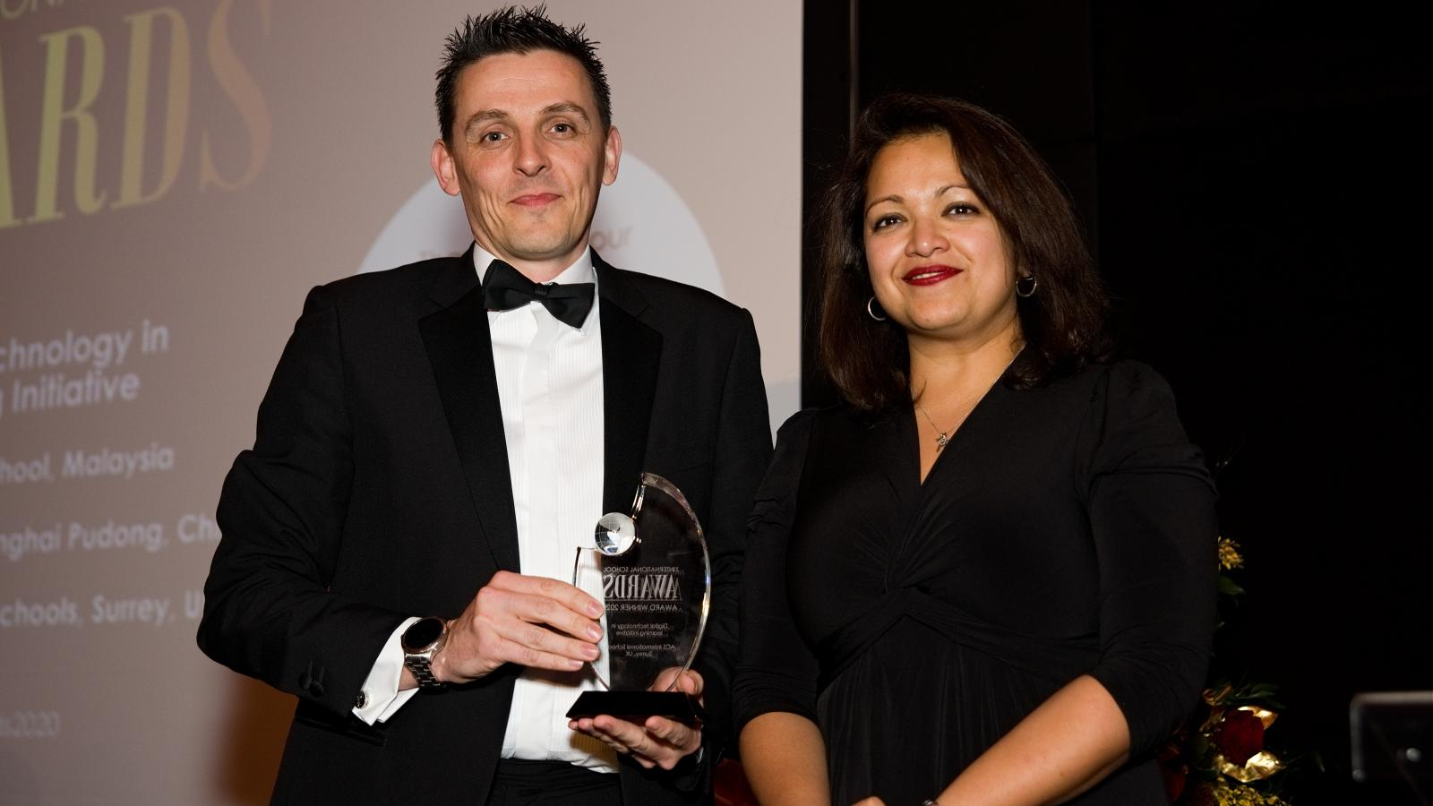 Graeme Lawrie receiving his award from Helen Konstantopoulous