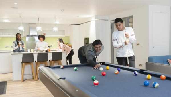 Boarders playing pool