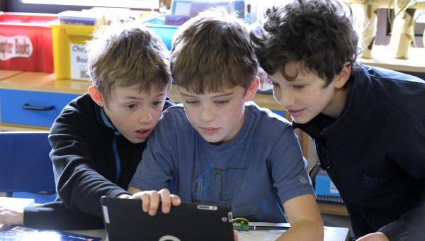 lower school children using an Ipad