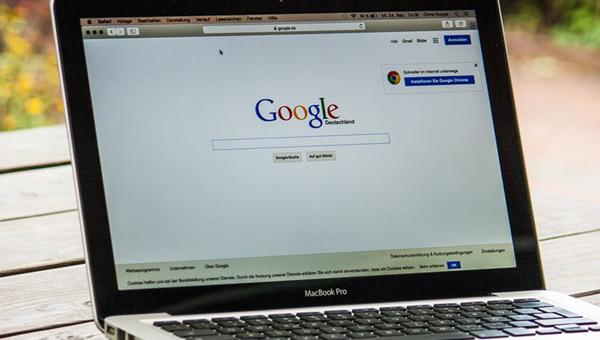 Laptop on desk with Google page opened on screen