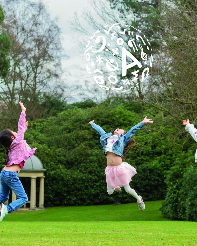 Children outside jumping in the air with the ACS logo above