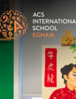ACS Egham logo with paintings in the background