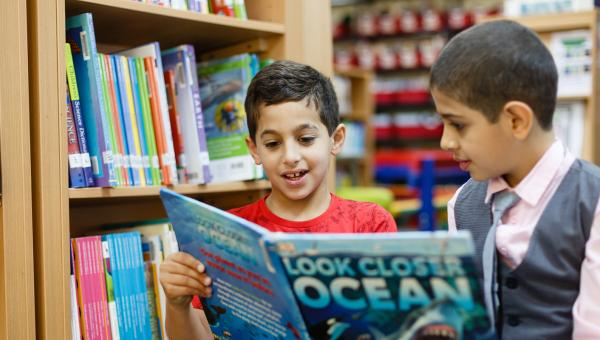 Lower School curriculum ACS Doha students in library