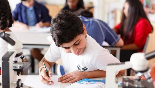 Middle School curriculum ACS Doha student working