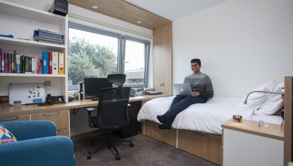 Student in new woodlands boarding room