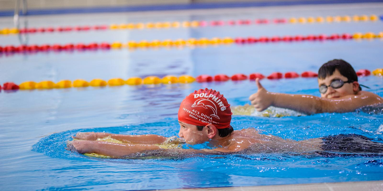 Sport Curriculum ACS Doha students competing in swimming pool