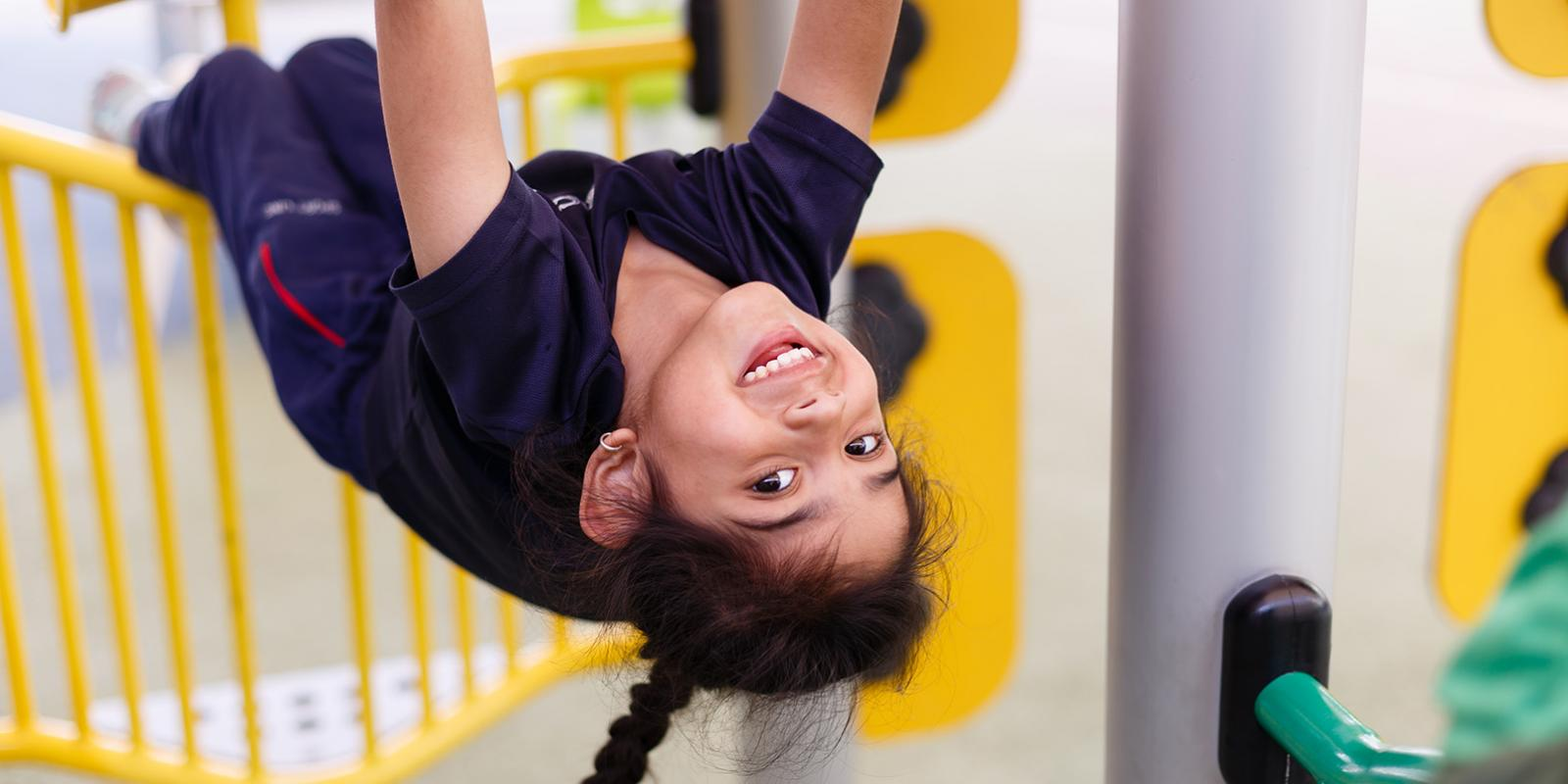Early Childhood curriculum ACS Doha girl on climbing frame