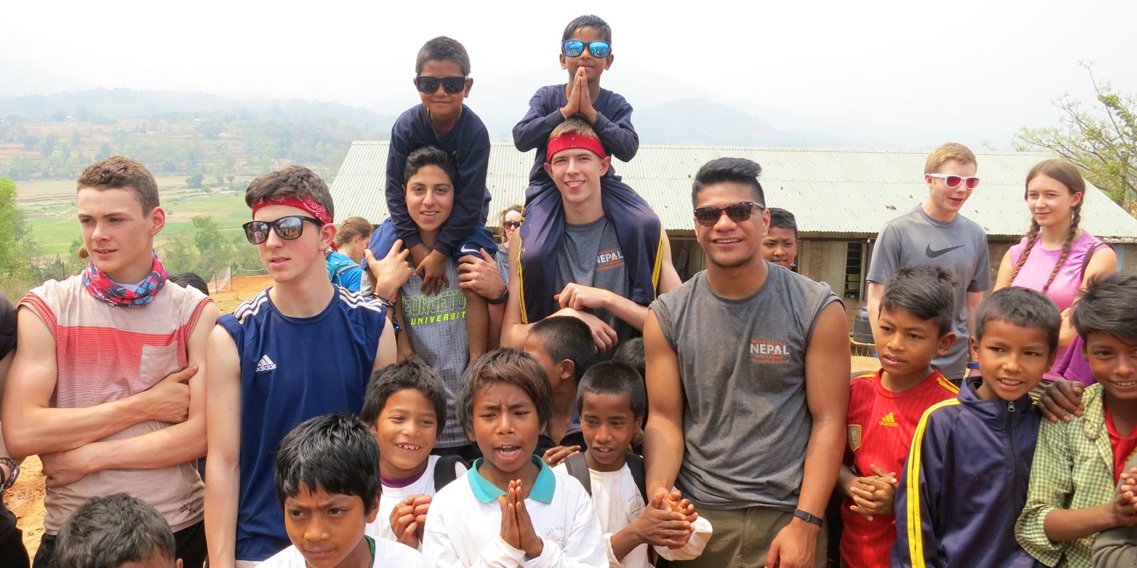Egham students with children in Nepal during outreach programme