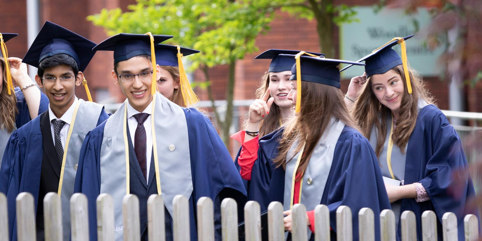 Egham 2018 graduates walking through the campus