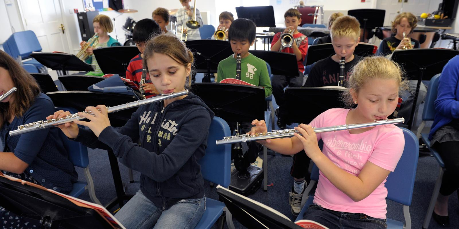 Students playing instruments in a music class