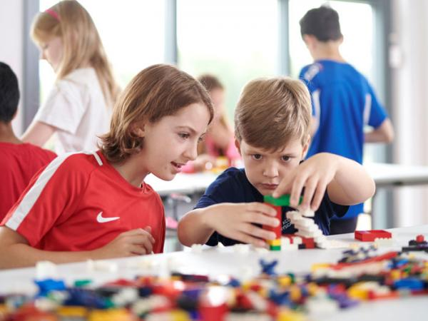 Two students building a lego model