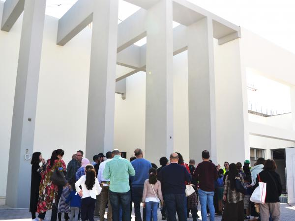 People standing outside the new ACS Doha campus in Qatar