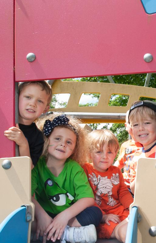 Group of Lower School students above playground slide