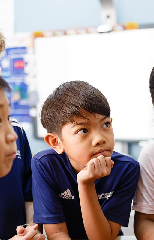 Lower School students looking at teacher