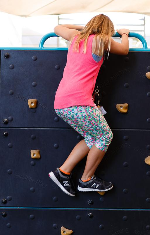 Activities covered student on climbing wall