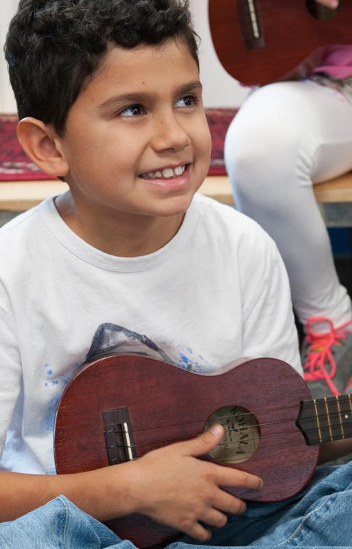 ACS Egham student playing guitar in music lesson