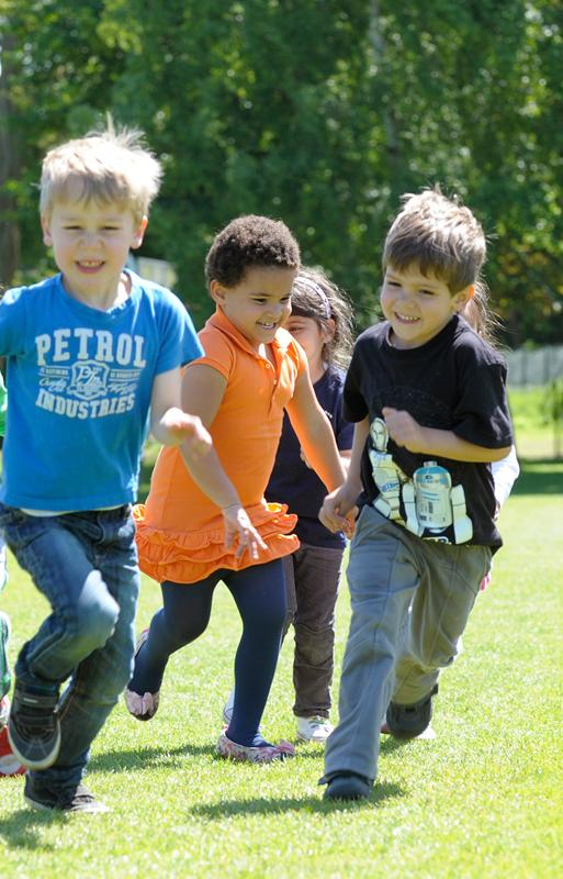 Egham students running in playground