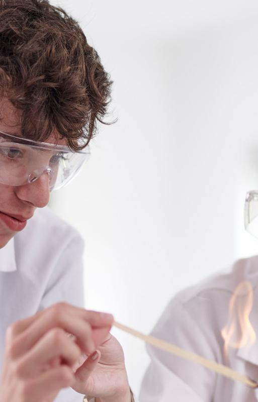 Two Science students experimenting with bunsen burner
