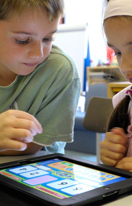 Lower School students using iPads